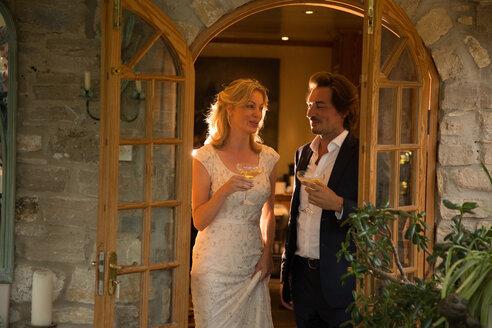Newlyweds at wedding reception - CUF47477