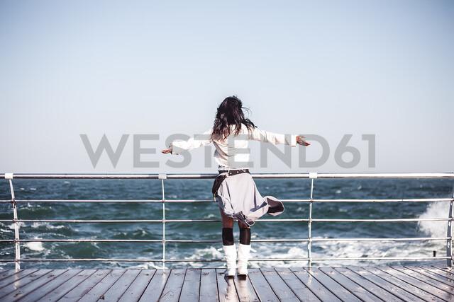 Mid adult woman looking out from pier with arms open, rear view, Odessa, Odeska Oblast, Ukraine - CUF47540 - Rehulian Yevhen/Westend61