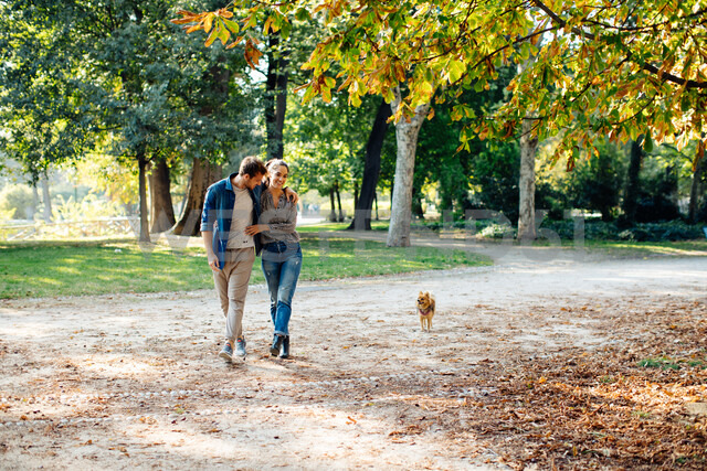 Couple with pet dog in park - CUF47600