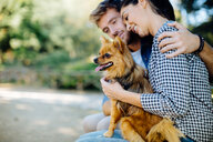 Couple with pet dog in park - CUF47609
