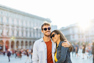 Couple sightseeing, Piazza del Duomo, Milan, Italy - CUF47621