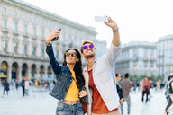 Couple taking selfie, Piazza del Duomo, Milan, Italy - CUF47624