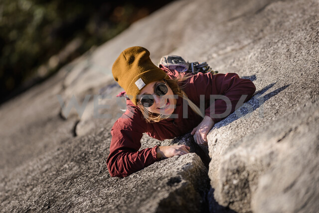 Rock climber gripping onto cracks, Malamute, Squamish, Canada - CUF47657