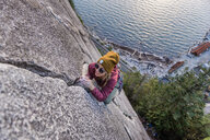Rock climber gripping onto cracks, Malamute, Squamish, Canada - CUF47660