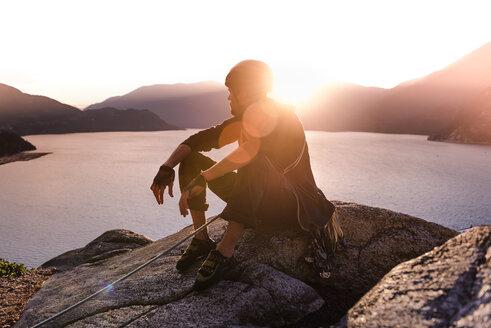 Rock climber enjoying sunset on Malamute, Squamish, Canada - CUF47666