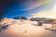 Skier on snow covered slopes, Madonna di Campiglio, Trentino-Alto Adige, Italy - CUF47699