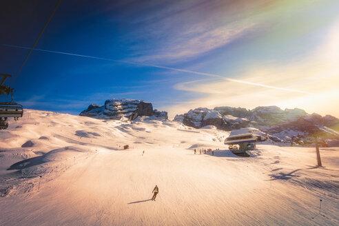 Skier on snow covered slopes, Madonna di Campiglio, Trentino-Alto Adige, Italy - CUF47699