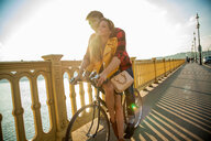Couple crossing bridge on bicycle, Budapest, Hungary - CUF47783