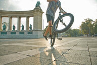 BMX cyclist doing wheelie, Heroes' Square (Hosök Tere), Budapest, Hungary - CUF47795