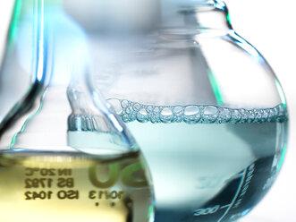 Laboratory beakers containing chemical formulas - CUF47801