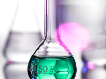 Laboratory beakers containing chemical formulas - CUF47804