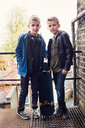 Twins posing with skateboard - CUF47810