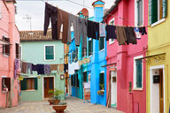Clothes lines in traditional multicoloured courtyard, Burano, Venice, Veneto, Italy - CUF47864