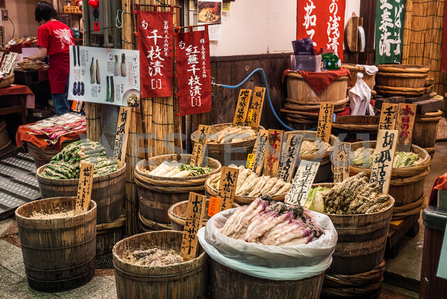 Groceries in barrels in shopping arcade street in downtown Kyoto, Japan - ASTF02128