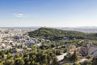 Greece, Athens, view on Odeon, theater of Herodes Atticus, Philopappos Monument, Piraeus in background - MAMF00337