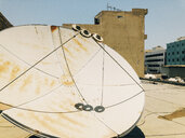 Bahrain, Manana, Large Satellite Dish on Rooftop in Middle East - JUBF00320