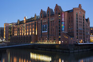 Germany, Hamburg, Speicherstadt, International Maritime Museum at dusk - WIF03741