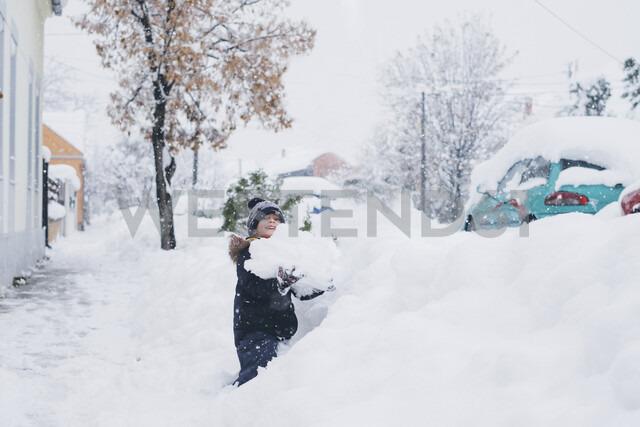 Toddler playin in the snow. Zrenjanin, Serbia - MOMF00585