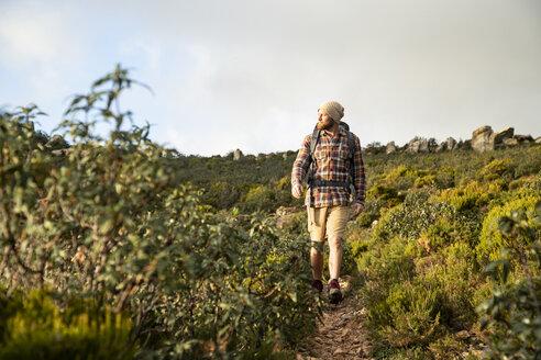Spain, Andalusia, Tarifa, man on a hiking trip walking on a trail - KBF00447
