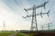 Field landscape with power lines near coal fired power station, Netherlands - CUF47920