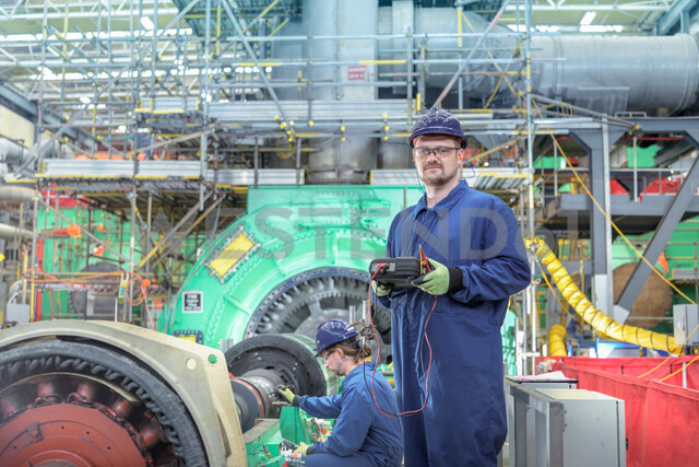 Portrait of engineer in turbine hall of nuclear power station during outage - CUF47956