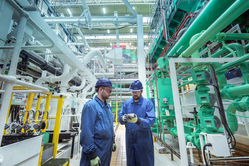 Engineers in turbine hall in nuclear power station - CUF47968