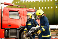 Firemen training, firemen in breathing apparatus carrying equipment - CUF47977