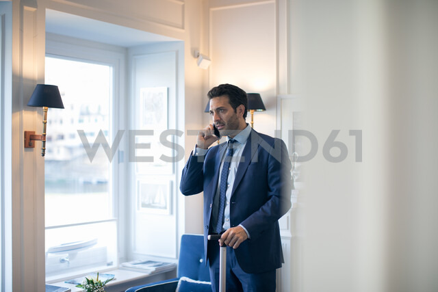 Businessman using smartphone in office - CUF48058