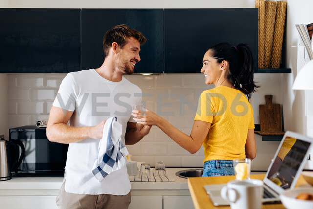 Young couple washing up in kitchen - CUF48115