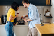Young couple cooking in kitchen - CUF48118