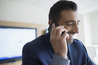 Close up smiling businessman talking on cell phone - HEROF05240