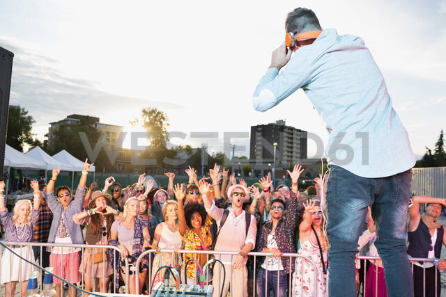 Crowd cheering musician on stage at summer music festival - HEROF05282