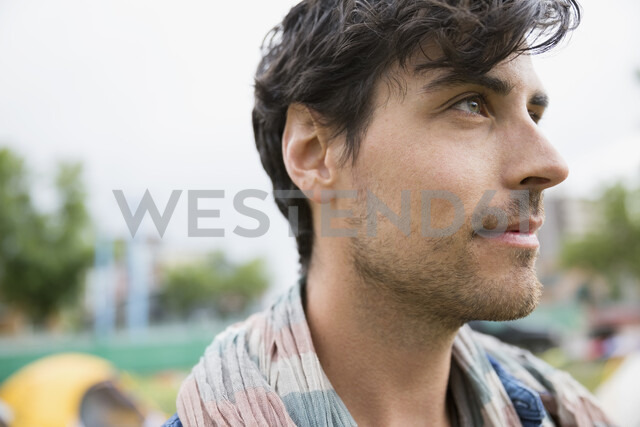Close up portrait pensive young brunette man looking away - HEROF05291