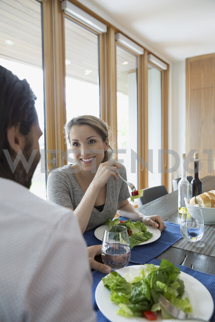 Couple eating salad at dining table - HEROF05345