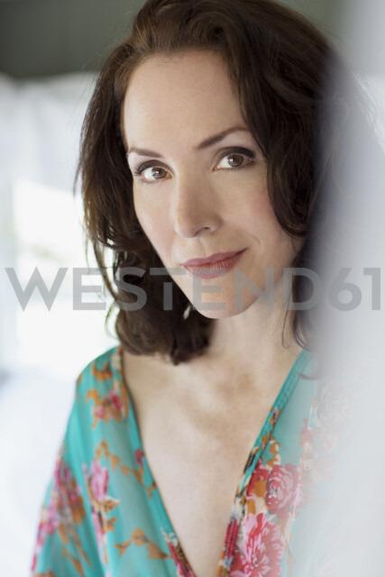 Close up portrait sensual mature brunette woman wearing silk robe - HEROF05366