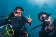 Scuba divers in Indian Ocean, Maldives - CUF48207