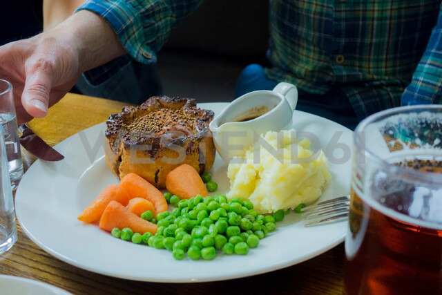Pie, mash and peas meal with beer in pub - CUF48318