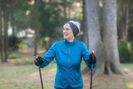 Senior woman nordic walking in park - CUF48357