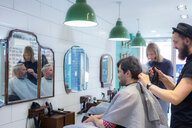 Barbers working in barbershop - CUF48363