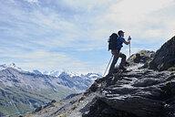 Hiker in Mont Cervin, Matterhorn, Valais, Switzerland - CUF48378