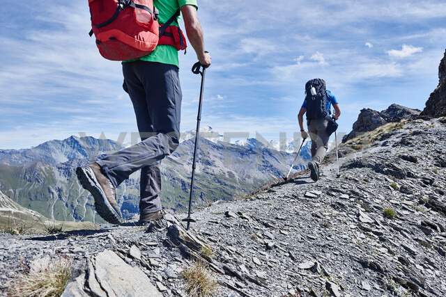 Hikers on ridge, Mont Cervin, Matterhorn, Valais, Switzerland - CUF48381