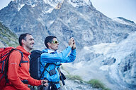 Hikers taking photograph, Mont Cervin, Matterhorn, Valais, Switzerland - CUF48387
