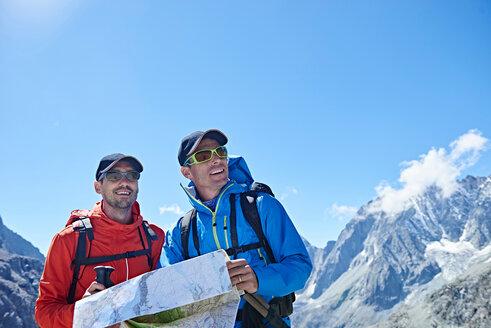 Hiker friends reading map, Mont Cervin, Matterhorn, Valais, Switzerland - CUF48393
