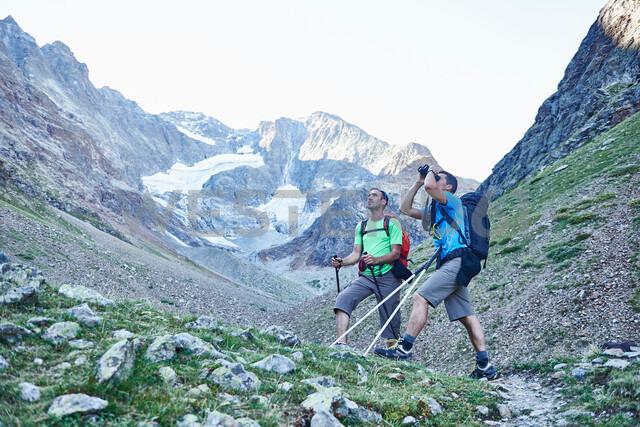 Hikers using binoculars, Mont Cervin, Matterhorn, Valais, Switzerland - CUF48423