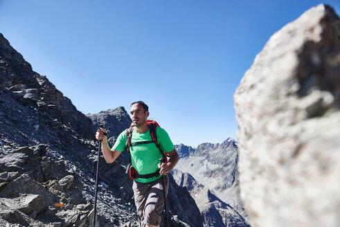 Hiker in Mont Cervin, Matterhorn, Valais, Switzerland - CUF48426