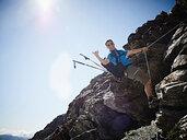 Hiker using rope to ascend rock face, Mont Cervin, Matterhorn, Valais, Switzerland - CUF48429