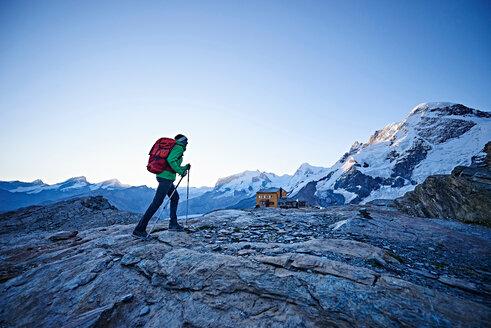 Hiker on rocky surface, Mont Cervin, Matterhorn, Valais, Switzerland - CUF48432