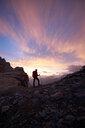 Hiker admiring sunset, Mont Cervin, Matterhorn, Valais, Switzerland - CUF48447