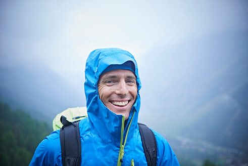Portrait of hiker in wet conditions, Mont Cervin, Matterhorn, Valais, Switzerland - CUF48453