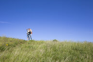 Mother and son taking selfies on a hill in Kullaberg, Sweden - FOLF10254